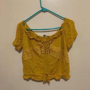 This is a mustard yellow crop top.